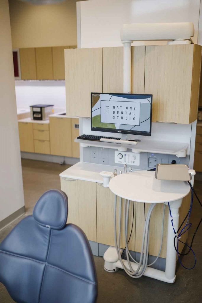 A dental exam room at Nations Dental Studio with an exam chair and dental tools